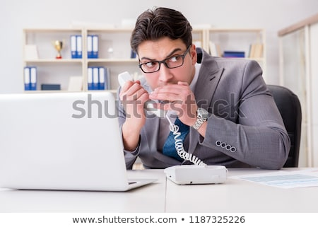Businessman leaking confidential information over phone Stock photo © Elnur