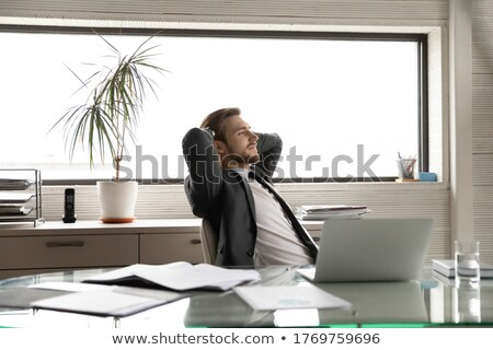 Businessman that relaxes in office and think about the future. double exposure Stock photo © alphaspirit