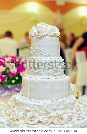 beautiful delicious white wedding cake at the evening stock photo © ruslanshramko