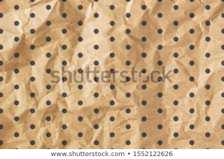 Brown craft paper with a black polka dot pattern Stock photo © Zerbor