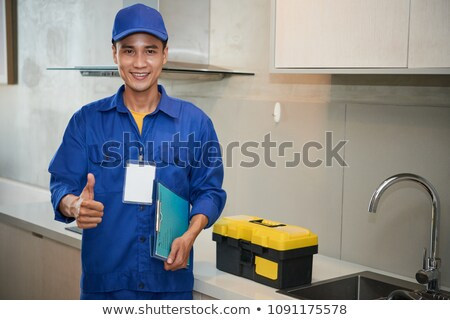 Young Technician Gesturing In The Kitchen Stock photo © AndreyPopov