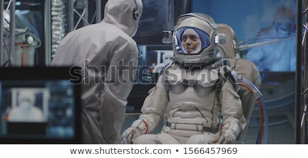 Three astronauts exploring space Stock photo © colematt