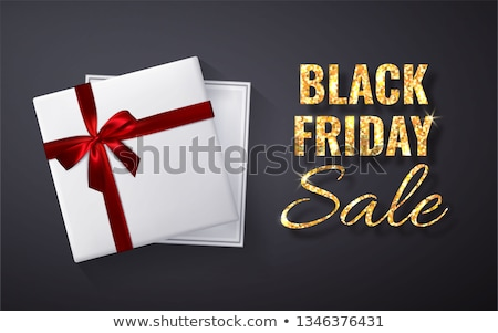 black friday sale golden glitter sparkleopen black gift box with red bow and ribbon top view vecto stock photo © olehsvetiukha
