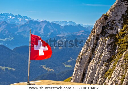 Swiss flag on boat flowing Luzern lake with Pilatus mountain bac stock photo © xbrchx