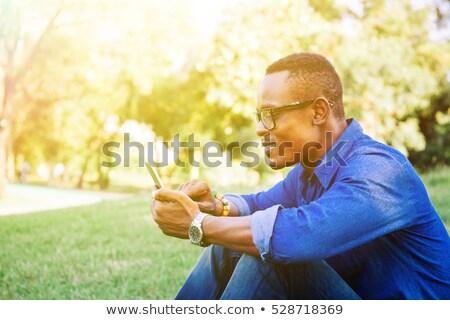 man · mobiele · telefoon · park · jonge · man · glas · kunst - stockfoto © deandrobot