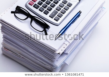 Calculator, Spectacle And Pen On Stacked Paper Stock photo © AndreyPopov