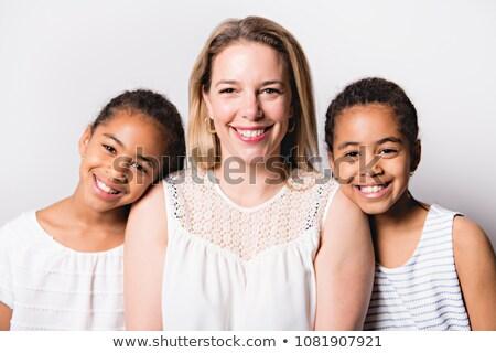 white skin caucassian mother with black twin in studio white Stock photo © Lopolo