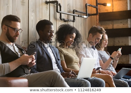 Grupo jóvenes electrónico personas Foto stock © AndreyPopov