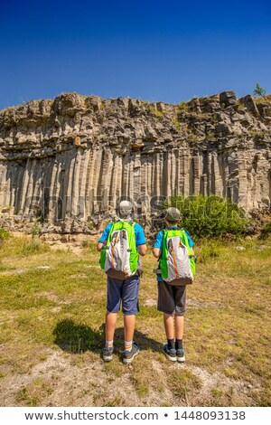 Kids looking at volcanic basalt coloumn Stock photo © grafvision