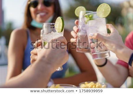 Woman with Cocktails, Lemonade Person Partying Stock photo © robuart