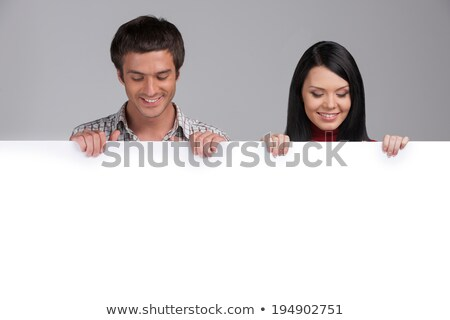 genç · kadın · gülen · arkasında · beyaz · çekici · panel - stok fotoğraf © nyul