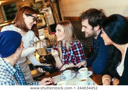 Homme amis payer café café personnes Photo stock © dolgachov