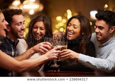 Sonriendo femenino amigos vino club nocturno Foto stock © wavebreak_media