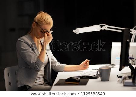 businesswoman rubbing tired eyes at night office Stock photo © dolgachov