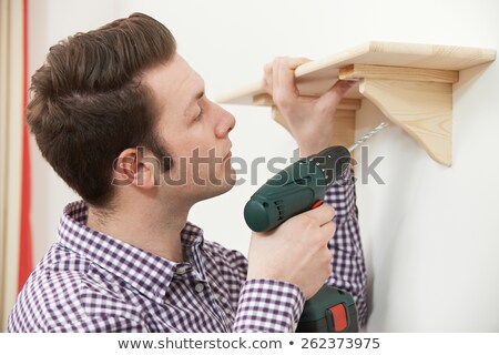 Człowiek w górę półka domu elektryczne Zdjęcia stock © HighwayStarz