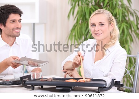 a couple eating food cooked with an electric plancha Stock photo © photography33