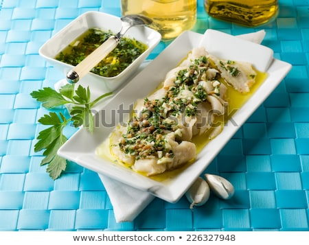 Stock photo: Fish with lemon and olive on plate