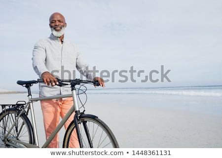 Stock photo: senior relaxing on the beach