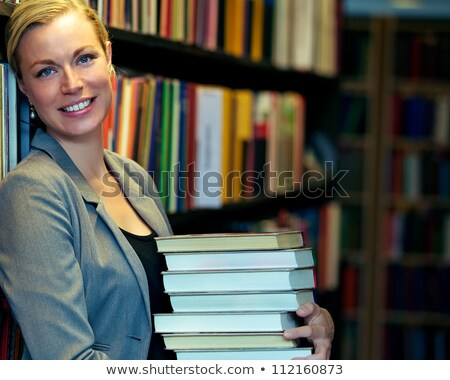 attractive blond carrying pile of books stock photo © photography33