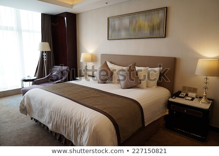 King sized bed in a suite Stock photo © stockyimages