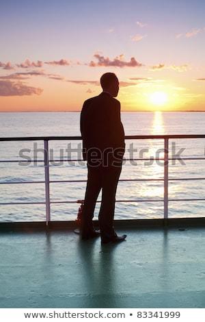молодые · черным · человеком · паром · лодка · свитер · плечо - Сток-фото © Schmedia