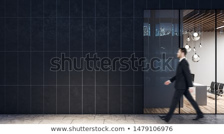 Businessman walking past office Stock photo © photography33