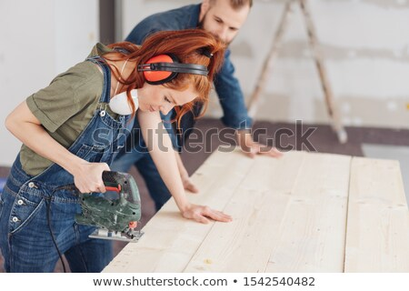 woman in dungarees preparing to decorate stock photo © photography33