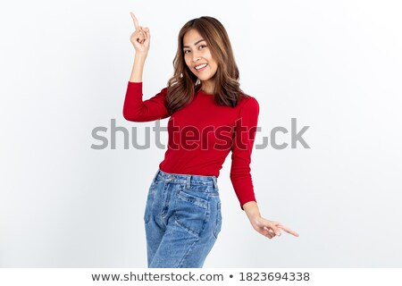 Close-up of a  young businesswoman showing with a finger at the camera against white background  stock photo © wavebreak_media