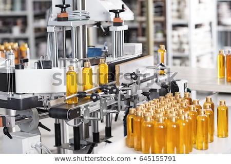 Laboratory bottle filled with yellow liquid Stock photo © Zerbor