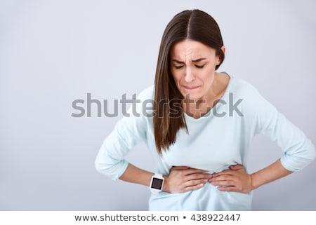 Mulher dor de estômago retrato sessão sofá água Foto stock © AndreyPopov
