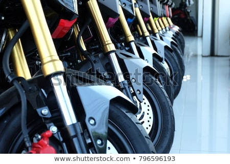 Line of new motorbikes in a shop Stock photo © smithore