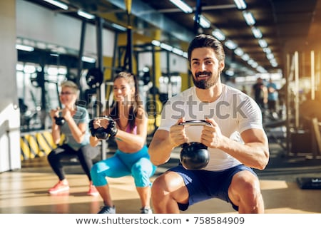young squatted bearded man stock photo © feedough