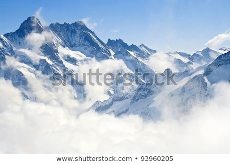 Winter mountains and cloudy sky Stock photo © BSANI