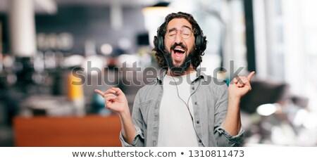 Stock photo: Man is dancing in head-phones