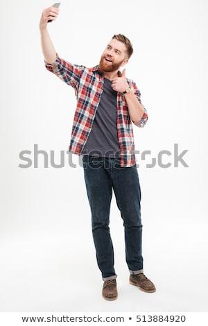 mosolyog · férfi · készít · fotó · okostelefon · teljes · alakos - stock fotó © deandrobot