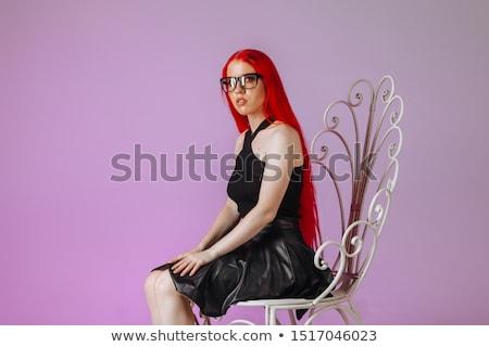 rocker · fekete · bőrdzseki · pózol · ülő · stúdió - stock fotó © feedough