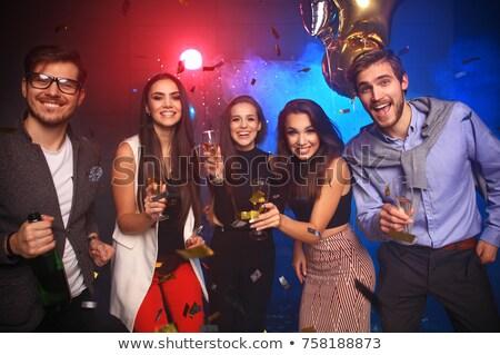 Asian Woman partying in night club Stock photo © Kzenon