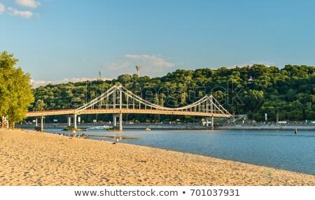 Gyalogos híd folyó tavasz építkezés háttér Stock fotó © Ava