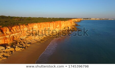 sunset over the coastal rocks with wild highl Stock photo © morrbyte