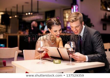 Young romantic couple reading the menu Stock photo © dash