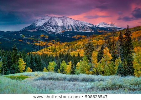 Peaks of rocky mountains covered with snow Stock photo © marekusz