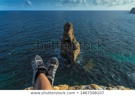 Foto stock: Large Rocks On Sea Shore Waters Edge