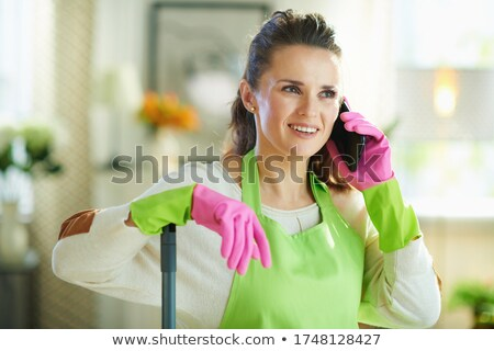 cleaner talking on a mobile phone stock photo © rastudio
