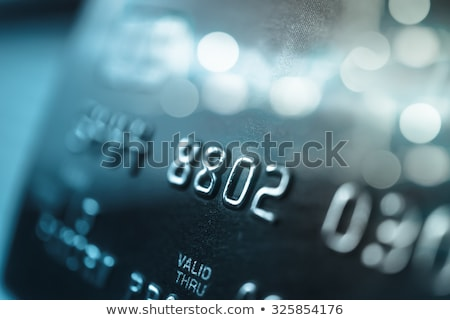 Coins and credit cards close up. Stock photo © borysshevchuk