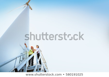 man and woman at wind turbine Stock photo © IS2