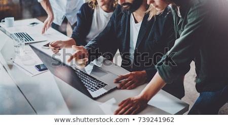 Business Statistics on Laptop in Modern Workplace Background. Stock photo © tashatuvango