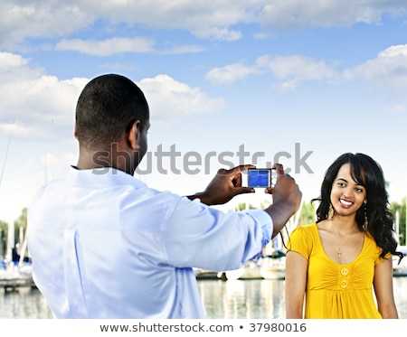 Man taking picture of woman on sailboat Stock photo © IS2