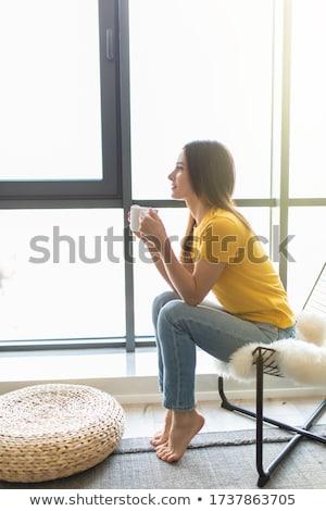 Kadın oturma pencere boş Stok fotoğraf © IS2