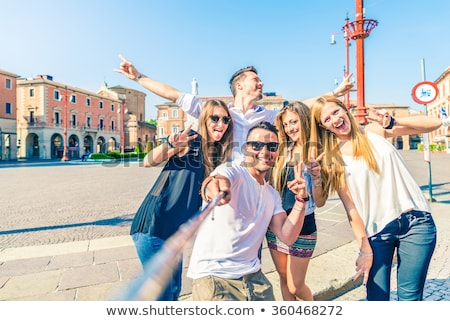 Attractive young couple in city square Stock photo © IS2
