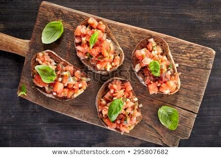 Bruschetta pan tomate albahaca fondo Foto stock © M-studio